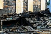 Abandoned Building After Fire House Completely Consumed By Fire Is Burnt To The Ground. poster