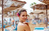 Sunscreen Woman. Girl Putting Sun Block On Beach Holding White Sun Tan Lotion Bottle. Beautiful Youn poster