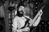Rock Singer Concept. Talented Musician, Singer. Musician With Beard Play Electric Guitar Musical Ins poster
