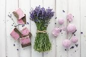 Lavender Soap, Bath Bombs And Beautiful Lavender Flowers On White Wooden Planks, Top View. Natural S poster