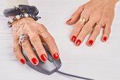Old Woman Manicured Hand Using Pc Mouse. Close Up Woman Hand With Luxury Rings And Bracelets Operati poster
