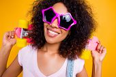 Head Shot Portrait Of Pretty Cool Chick In Summer Glasses Star Shape Holding Pink Skate Board On Sho poster