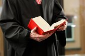 picture of court room  - German Lawyer with civil law code in a court room - JPG
