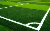 Green Grass Soccer Field. Empty Artificial Turf Football Field With White Line. View From The Corner poster