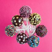 Chocolate Cake Pops In Glass, Decorated With Colorfull Confectionery Sprinkles On Pink Background. P poster