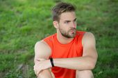 Athlete Wear Pedometer Bracelet On Hand. Athletic Man Relax On Green Grass. Checking Workout Results poster