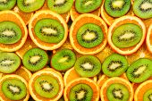 Fruity Background Set Of Slices Of Orange Fruit And Kiwi. Many Slices Of Kiwi Fruit And Orange Fruit poster