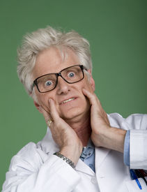 picture of mad scientist  - Portrait of mature man wearing white lab coat  - JPG