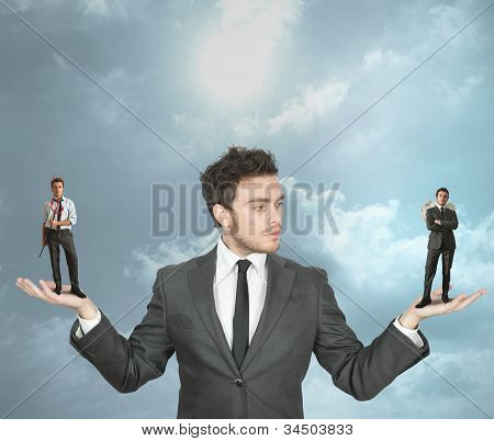 Businessman With Devil And Angel