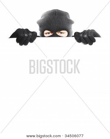 Isolated Robber Hiding Behind A Empty White Sign