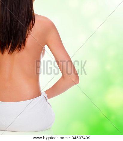 Naked female back on blurred background