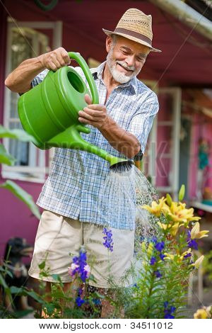 Watering The Flowers In  The Garden