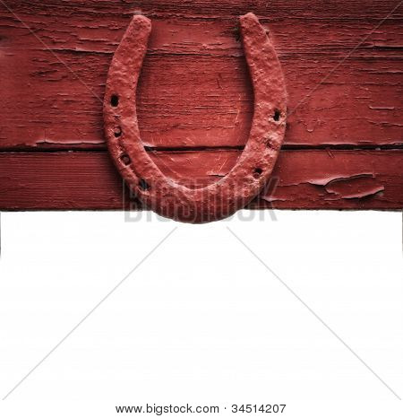 The Old Horseshoe Hanging On Wooden Wall