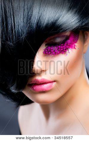 Fashion Brunette Model Portrait. Hairstyle. Haircut. Professional Makeup. False Eyelashes. Black Hair