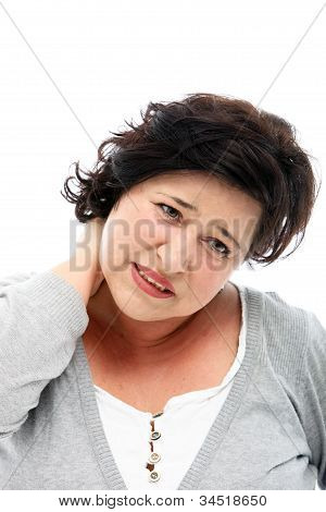 Woman Grimacing In Pain As She Rubs Her Neck