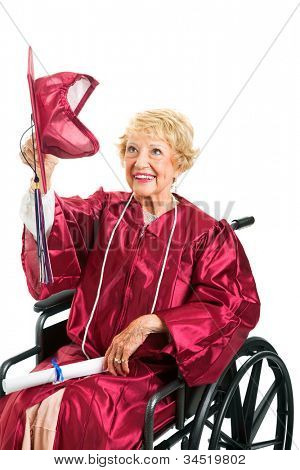 Disabled senior woman removes her graduation cap to throw it up in the air.  Isolated on white.