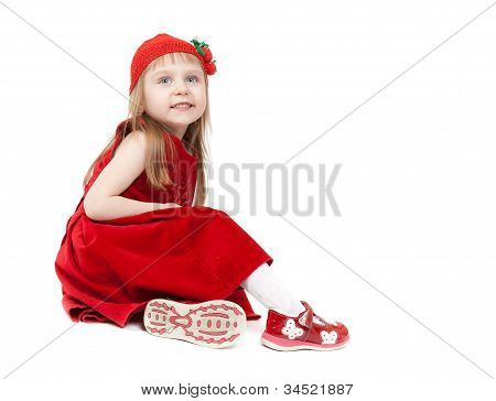 Beautiful Four-year-old Girl In A Red Dress And Hat Sitting On White Background