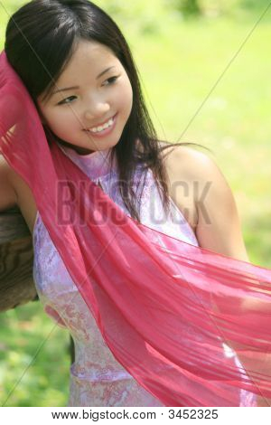 Beautiful Asian Female With Red Scarf