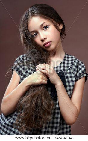 ?hildren ?ortrait of the beautiful girl. 10 years.