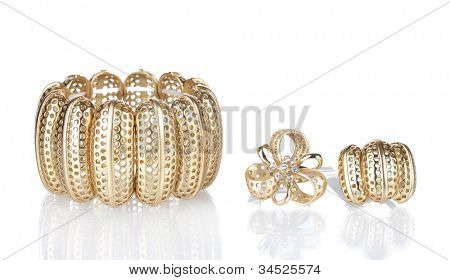 Beautiful golden bracelet and rings isolated on white