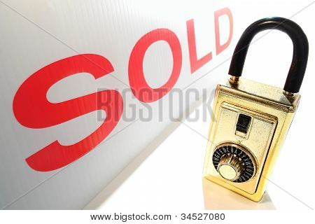 Real Estate Realtor Key Lock Box And Red Sold Sign