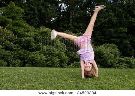 Little Girl Doing A Cartwheel