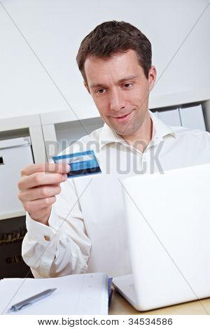 Business man buying online with credit card and laptop