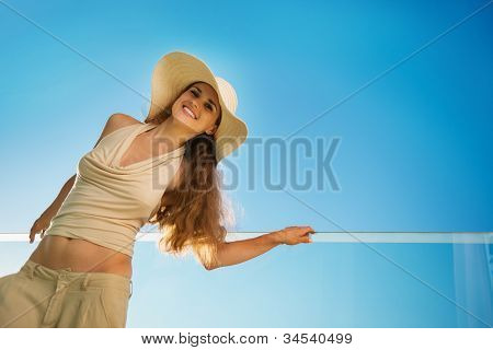 Smiling Woman Standing On Balcony