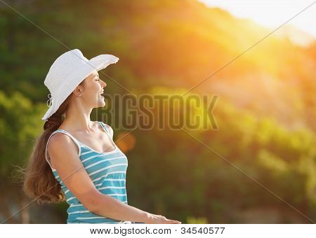 Portrait Of Happy Woman On Vacation Enjoying Sunset