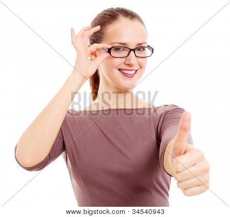 Cheerful young woman holding eyeglass frame and showing thumb up symbol. Isolated on white background, mask included