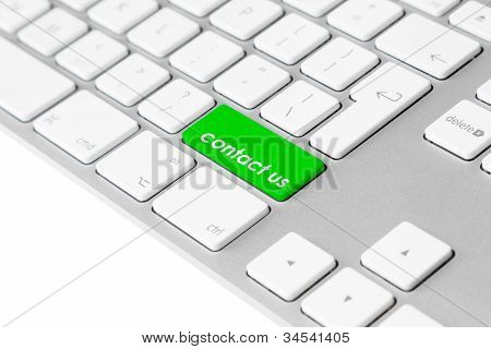 "Computer keyboard with green ""contact us"" button"