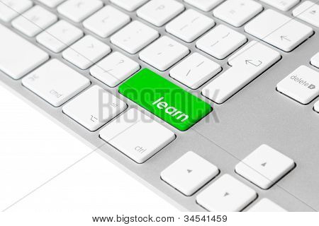 "Computer keyboard with green ""learn"" button"