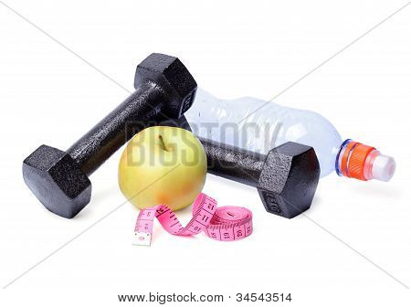 Dumbbells, Apples, Centimeter And Bottle On White Backg