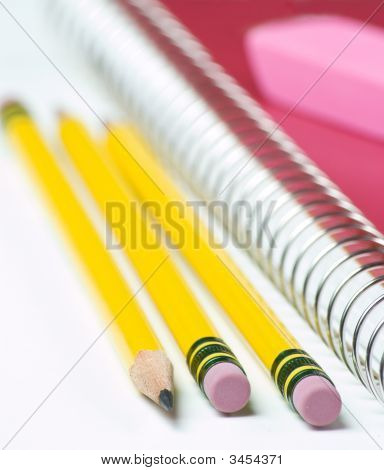 Three Pencils With Notebook