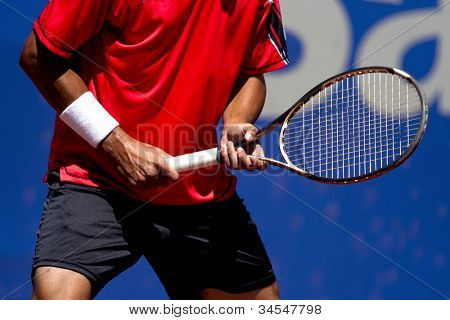 A tennis player waiting for a serve during a match