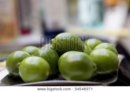 Fresh green lemon on bar table ready for prepaing ccktail