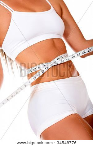 Healthy woman loosing weight - isolated over a white background