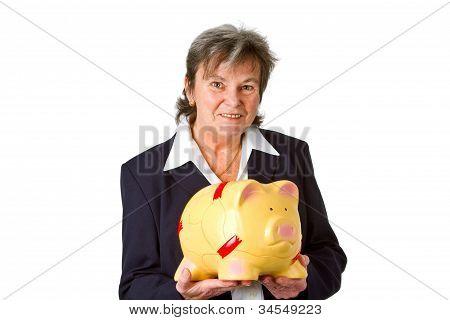 Female Senior With Piggy Bank