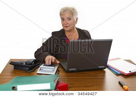 Calculating Female Senior With Laptop