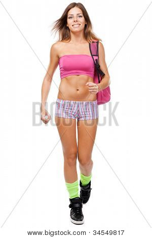 Young fit woman in sports outfit, isolated on white background