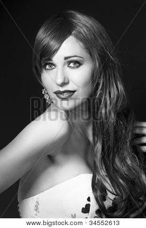 Portrait of the beautiful nice woman with ringlets hair in black and white