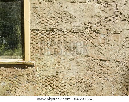 Exterior surface of plastered wall with wire mesh
