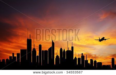 Conceptual Photo Of City Downtown At Sunrise/sunset With Skyline Silhouette Against A Beautiful Oran