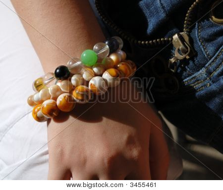 Girlish Hand With Different Bracelets, Close-Up