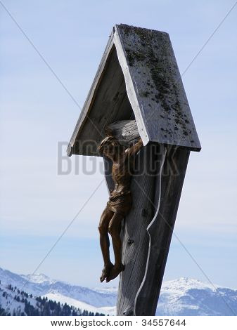 Crucifix in mountains