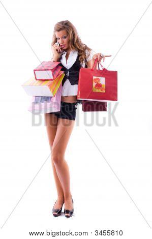 Close-Up Of Happy Young Woman On A Shopping Spree. Talking By Phone
