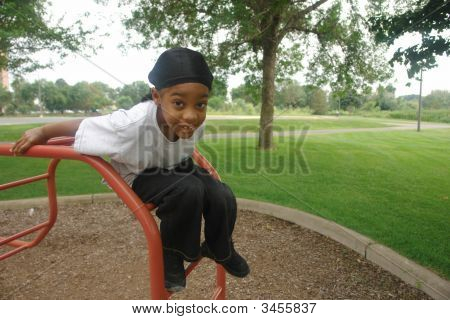 African American Boy Playing On Playground