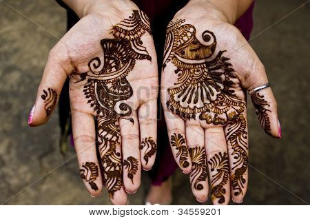 Henna applications during Indian wedding celebrations