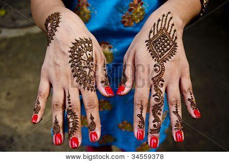 Artistic Henna artwork designs applyed at Indian Wedding celebrations