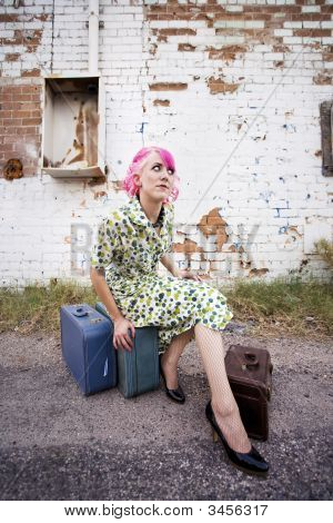 Woman With Pink Hair And A Small Suitcases